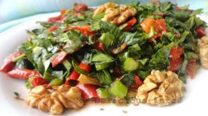 Celery leaves salad with dried peepers and tomatoes