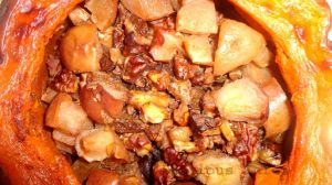 Filled pumpkin with apples, raisins, cranberries, honey, cinnamon and allspice